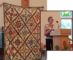 Irene Lafleche and one of her quilts